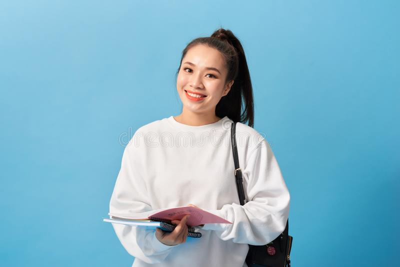 College Student girl. Isolated portrait of a beautiful young asian woman student royalty free stock images