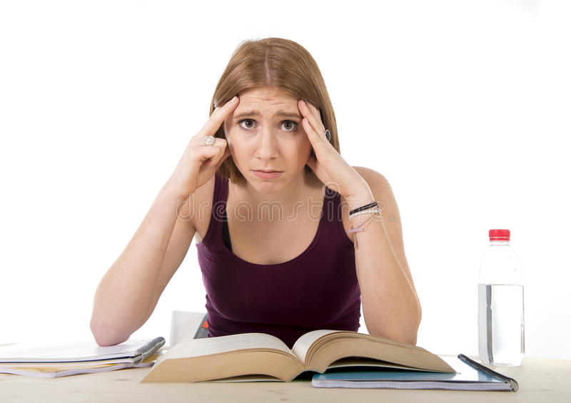 College student girl studying for university exam worried in stress feeling tired and test pressure. Young beautiful college student girl studying busy for stock photography
