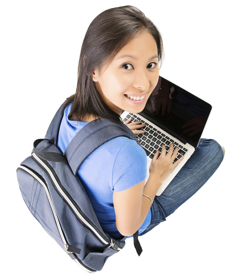 College student with laptop. Beautiful smiling Asian student girl on white background holding a laptop stock photos