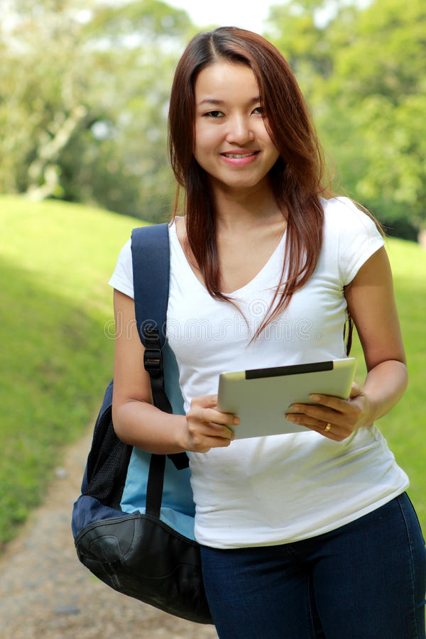 College student look happy studying using a tablets royalty free stock images
