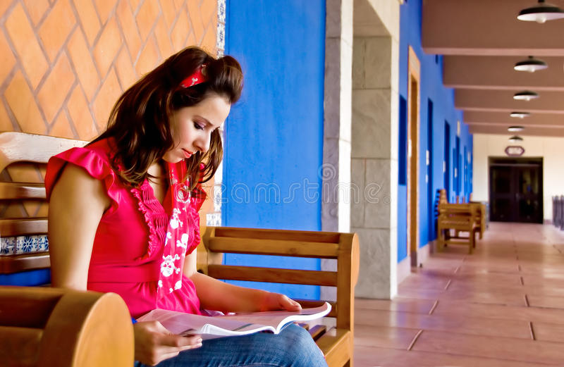 College student reading in the hallway stock images
