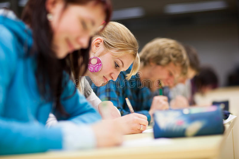 Download College Student Sitting In A Classroom Stock Image - Image: 21629375