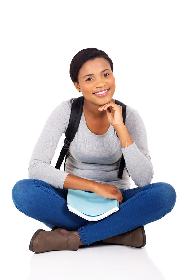 College student sitting. Happy african female college student sitting on white background stock images