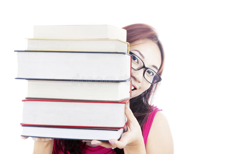 College Student Smiling Behind Books Royalty Free Stock Photos