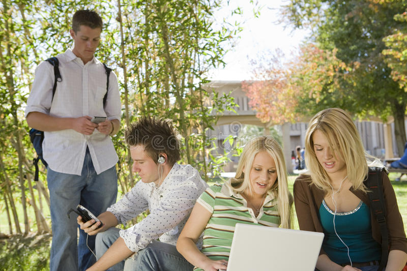College Student Using Technologies On Campus stock photography