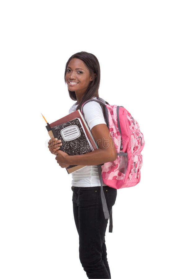 College student young African American woman. Education series - Friendly ethnic black female high school student with backpack and composition book stock photo