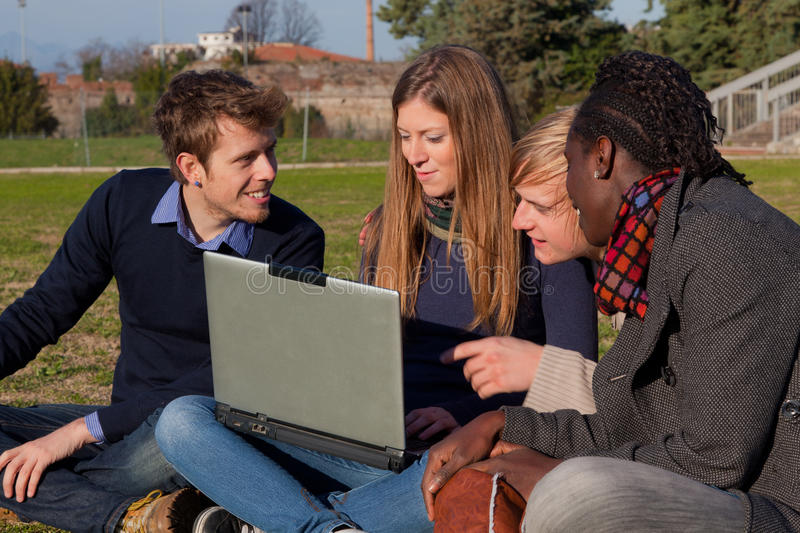College Students. With Computer at Park royalty free stock image