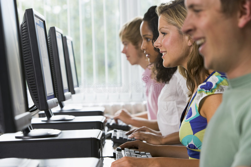 College students in a computer lab.  royalty free stock photos