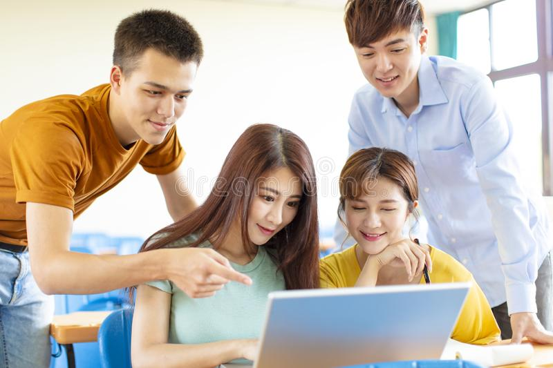 College students  discussing ideas in classroom stock photo