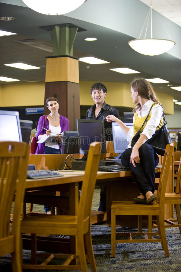 College students hanging out by library computers royalty free stock photography