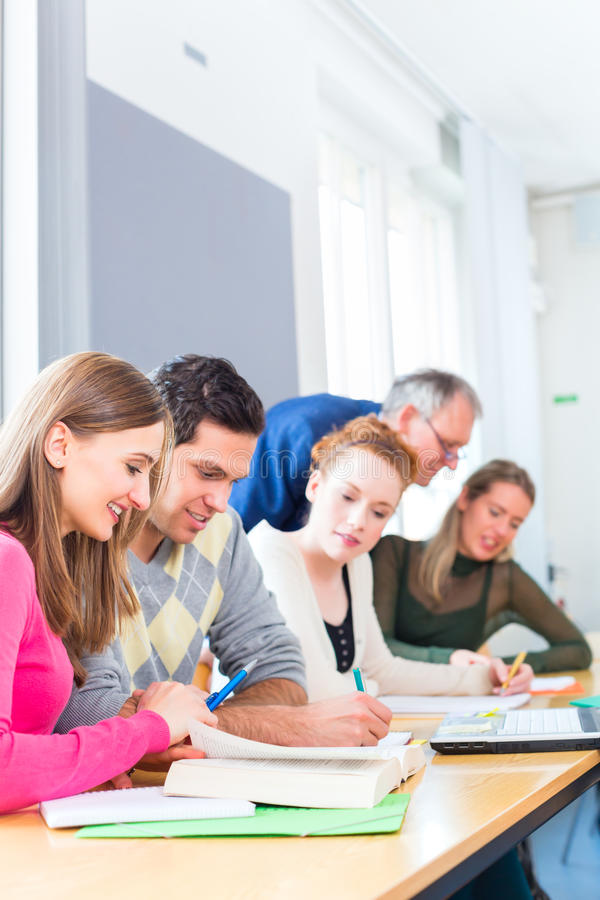 College students learning with professor stock images