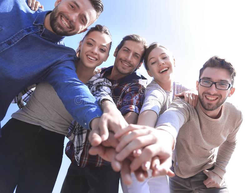 College Students Teamwork Stacking Hand Concept. Active young people ,with hands clasped together.photo with copy space royalty free stock image