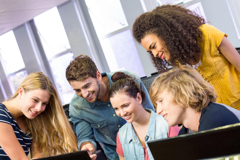 College students using computer. Group of college students using computer stock image