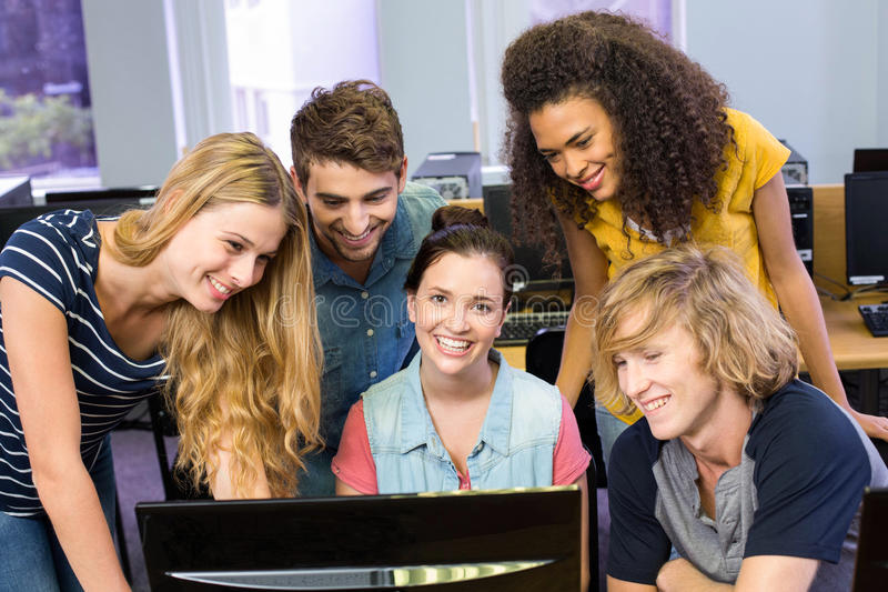 College students using computer. Portrait of college students using computer royalty free stock images