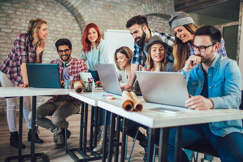 College students using laptop while sitting at table. stock photography