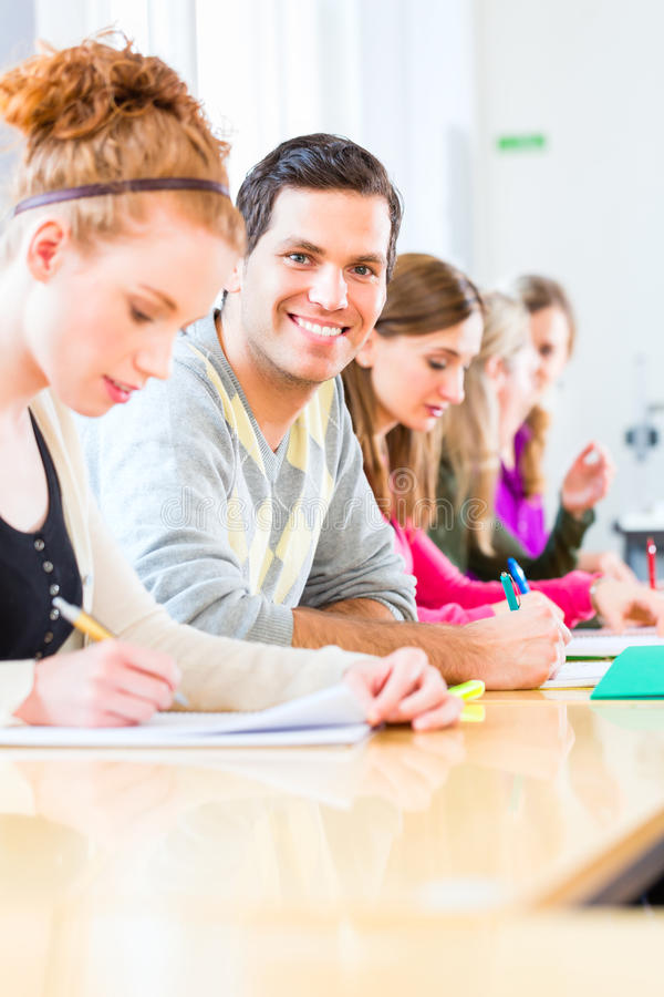 College students writing test royalty free stock photos