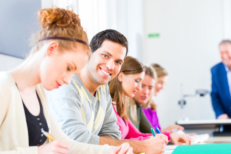 College students writing test stock images