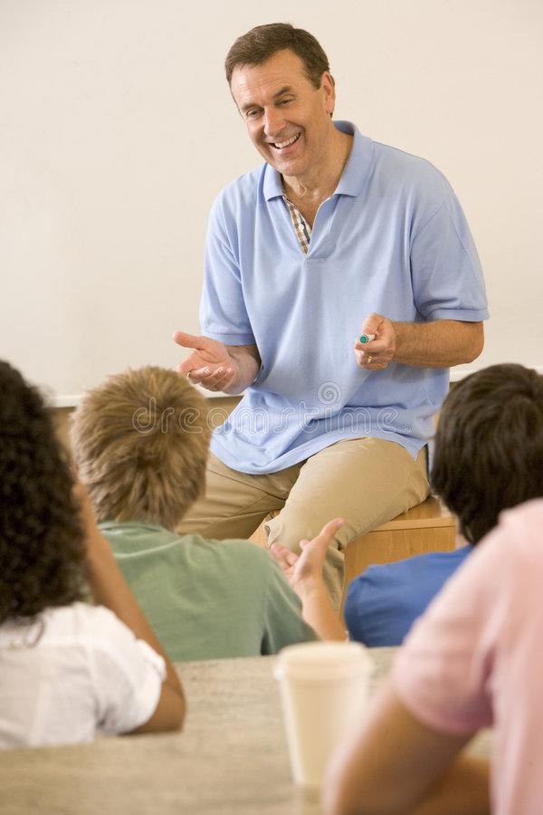 College teacher giving a lecture stock photography