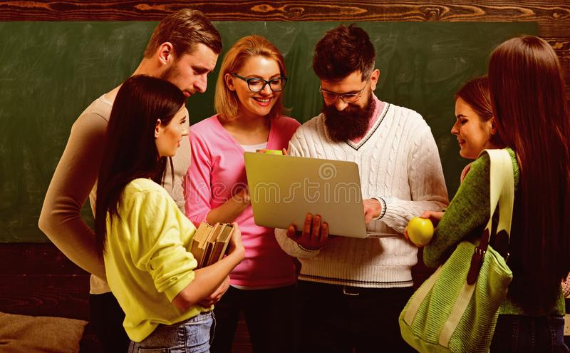 College and university concept. Group of students, groupmates spend time with teacher, lecturer, professor. Students royalty free stock photo