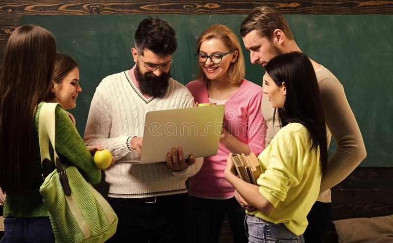 College and university concept. Group of students, groupmates spend time with teacher, lecturer, professor. Students stock photography