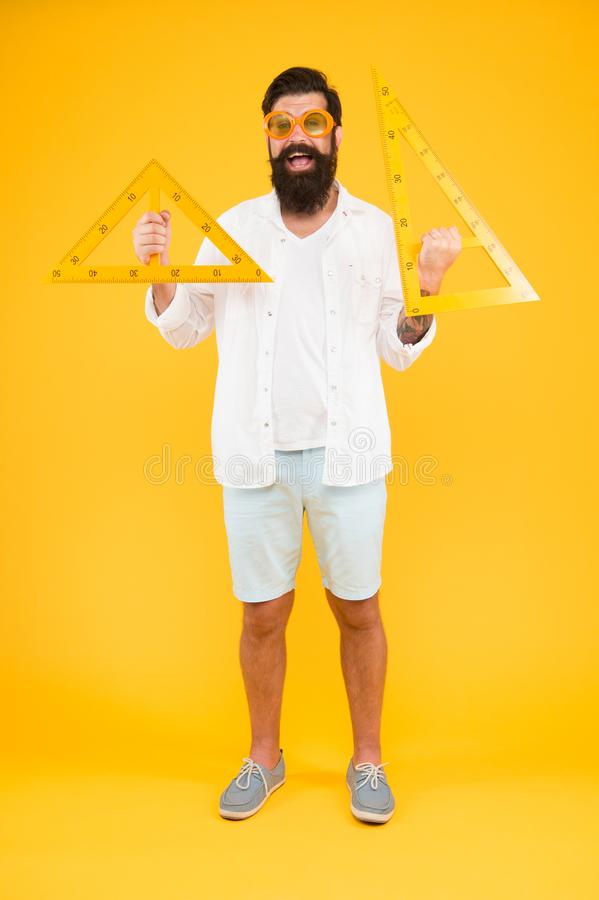College university education. Bearded nerd with triangle. Exploring properties. Man math lesson. Student using measuring royalty free stock photography