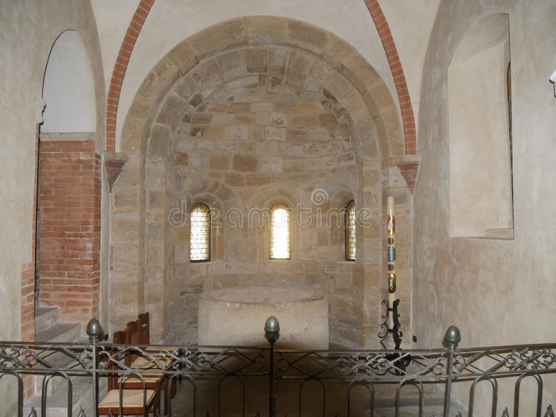 Collegiata church of St Mary in Castell`Arquato. The interior has sculpted capitals, sculptures, baptismal pieve and frescoes stock photo