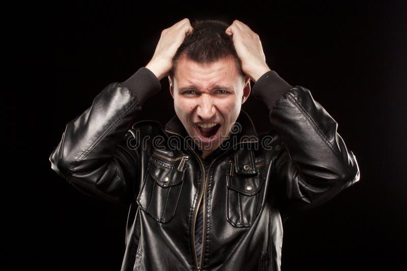Collera - grido dell'uomo arrabbiato fotografia stock libera da diritti