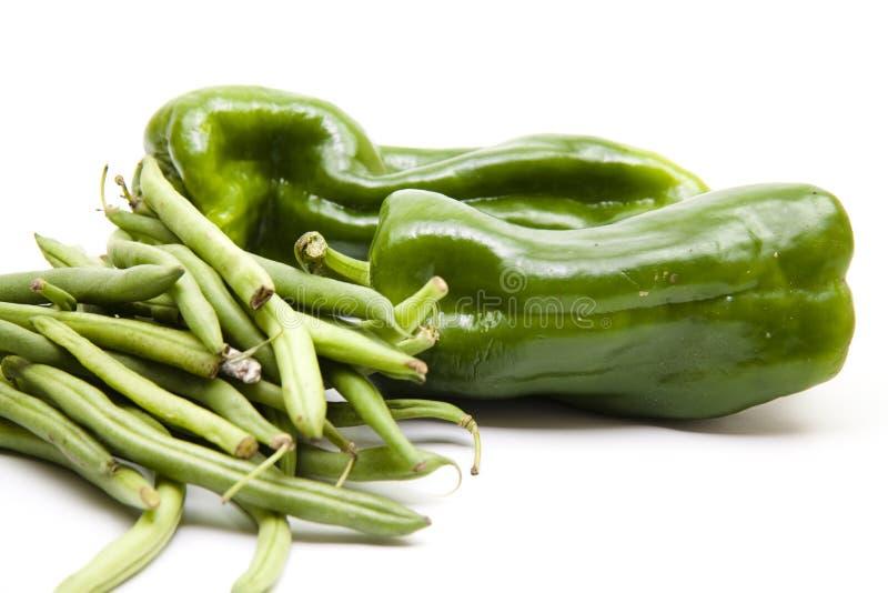 Collez les haricots avec des paprikas photographie stock