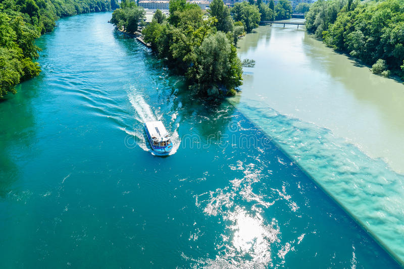 Colliding Rivers in Geneva. Two rivers junction, the Rhone and the Arve, in Geneva, Switzerland. The river on the left is the Rhone, which is just exiting Lake stock image