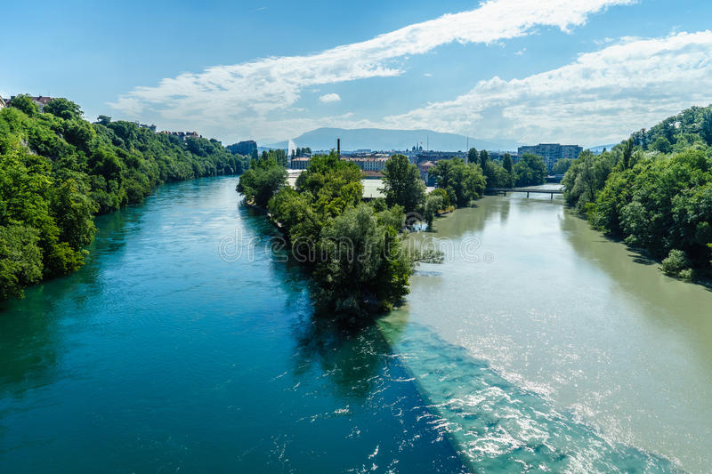 Colliding Rivers in Geneva. Two rivers junction, the Rhone and the Arve, in Geneva, Switzerland. The river on the left is the Rhone, which is just exiting Lake stock images