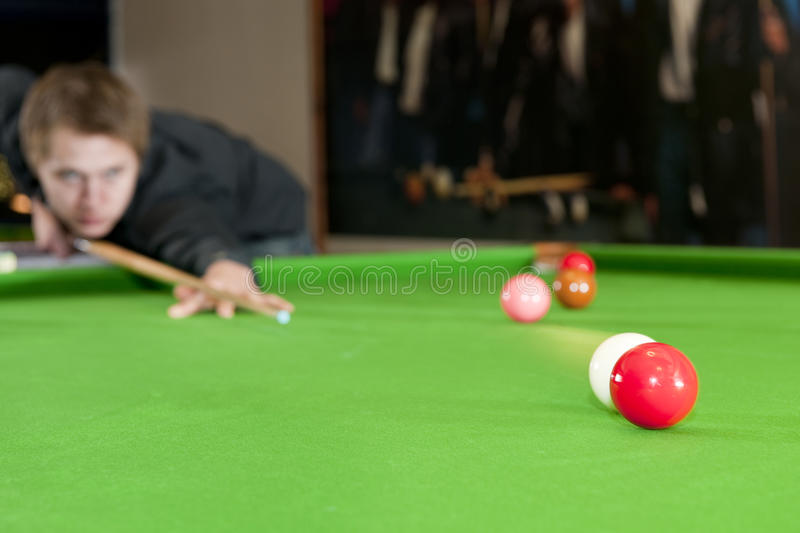 Colliding snooker balls. Cue ball colliding with a red ball on a snooker table royalty free stock image
