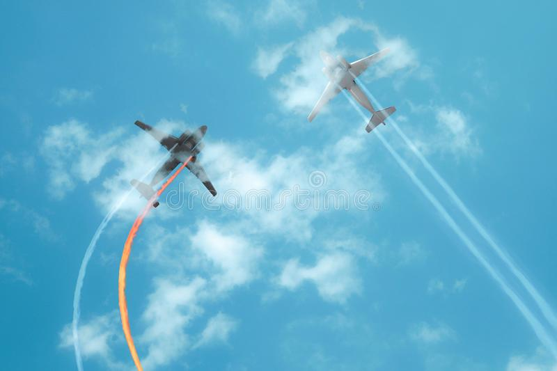Collision in the air. Two airplane collapse in flight. Aviation accident in blue sky. Damaged engine with fire whirlwind. View royalty free stock images