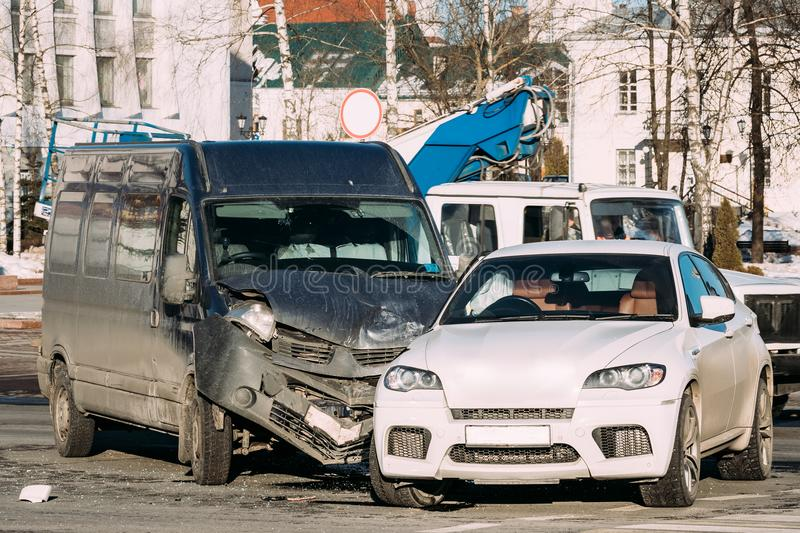 Collision Of Two Cars. Crashed Minibus And Luxury Crossover SUV Cars. In City Street. Car Wreck, Accident stock photo