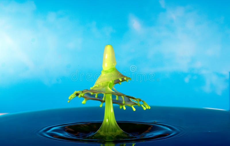 Collision of two drops on a surface of water stock photo