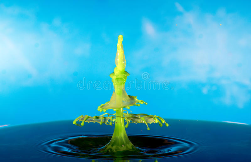 Collision of two drops on a surface of water stock image