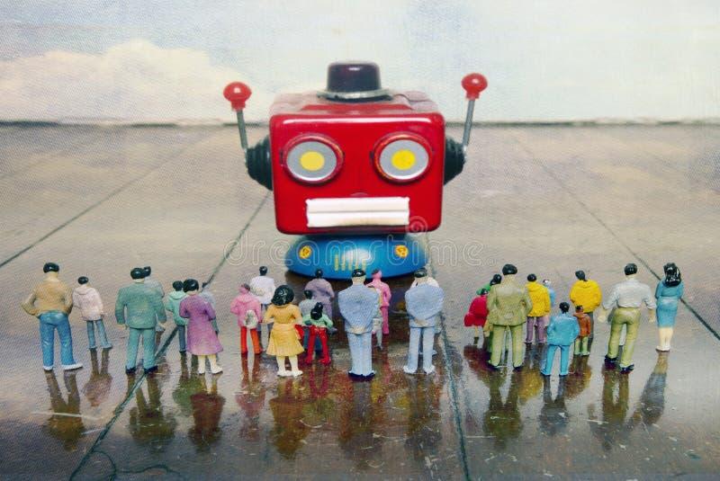 Colloqui capi del robot rosso all'cantato della gente di plastica o fotografia stock libera da diritti
