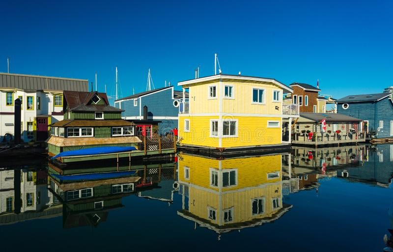 Colorful village of float homes on bright sunny day, blue sky. royalty free stock photography