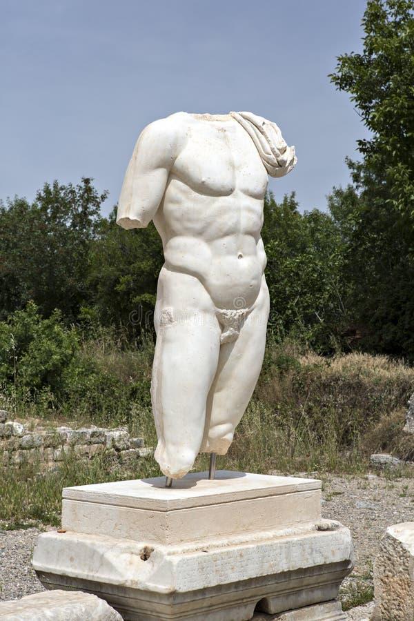 Collosal torso of naked male god in Hadrian bath of Aphrodisias royalty free stock photos