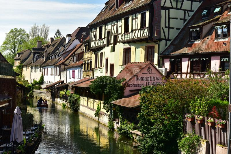 Romantic boat trip along the canal in the little Venice of Colmar. France. COLMAR, FRANCE - APRIL 18, 2019. Romantic boat trip along the canal in the little royalty free stock images