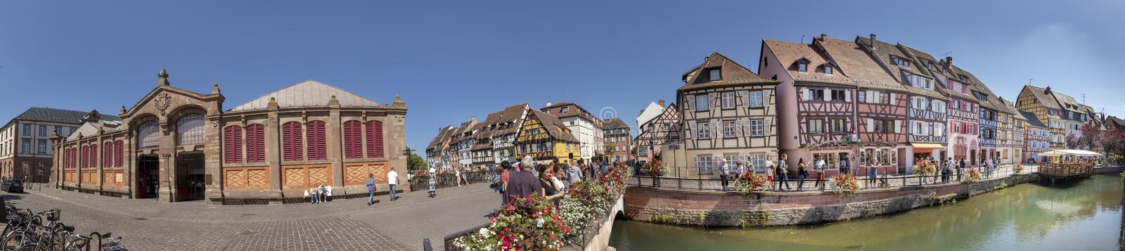 people visit the area little venice with traditional buildings in the old town of Colmar stock images