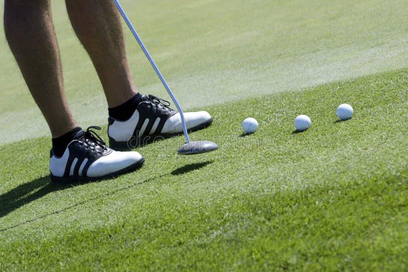 Colocação do jogador de golfe foto de stock