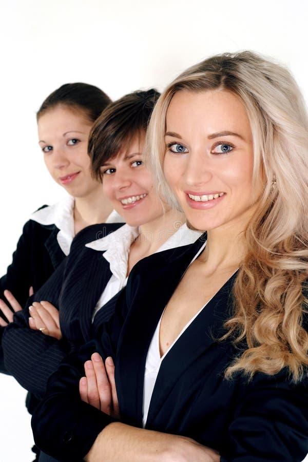 Colocación de tres mujeres de negocios fotografía de archivo libre de regalías