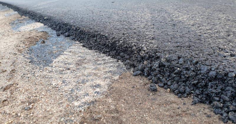 Colocación del asfalto en suelo condensado imágenes de archivo libres de regalías