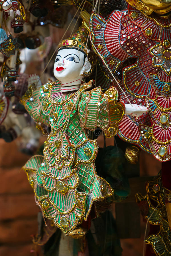 Coloful Burmese puppets. A selection of wooden burmese puppets in traditional costume stock photos