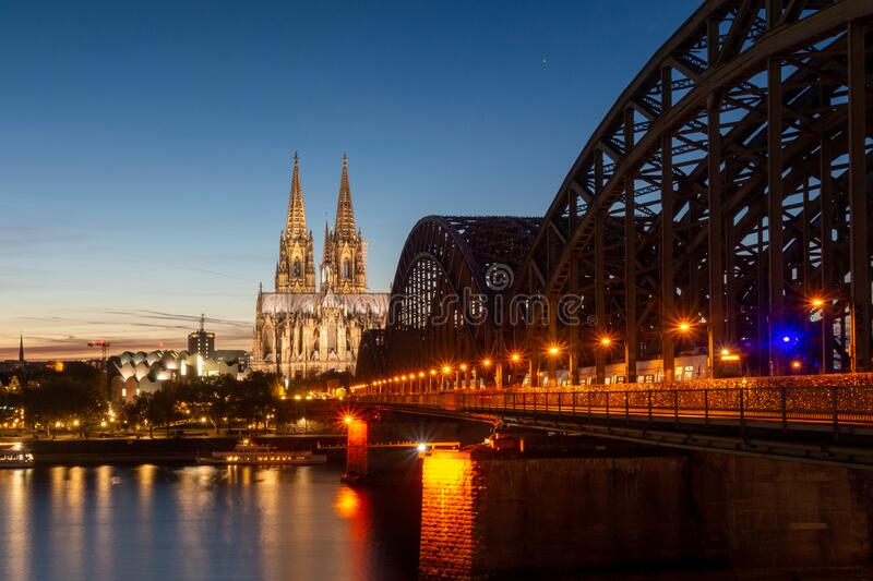 Cologne Cathedral and the bridge during a sunset stock image