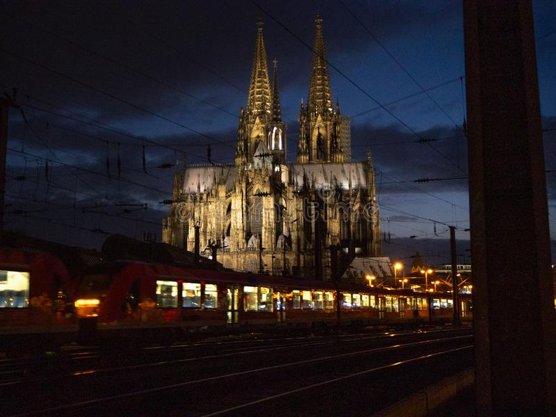 Cologne cathedral at night with a train passing through. Cologne cathedral at night with a train passing through at central station stock photography