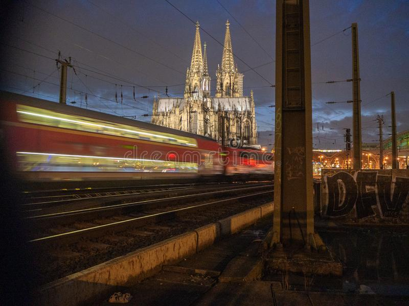 Cologne cathedral at night with a train passing through. Cologne cathedral at night with a train passing through at central station stock image
