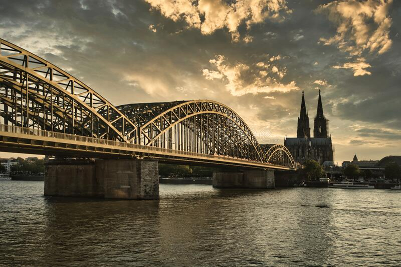 Cologne Cathedral with River Rhine at sunset royalty free stock photo