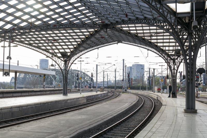 Cologne, GERMANY - April 7, 2018: platform in morning at Cologne Railway Main Station. Cologne, GERMANY - April 7, 2018: Public platform in morning at Cologne stock photography