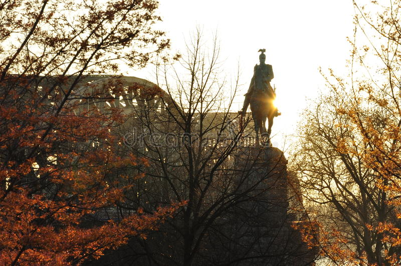 Cologne, Germany. Kaiser Wilhelm II statue. Equestrian statue of kaiser William the second of Germany, in Cologne. Railway bridge at dawn stock image